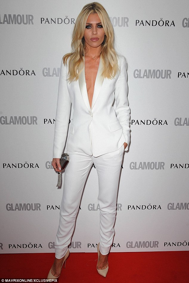 white suits for women abbey crouch dresses down in a furry parka and trainers as she lugs  shopping HWCOVMC