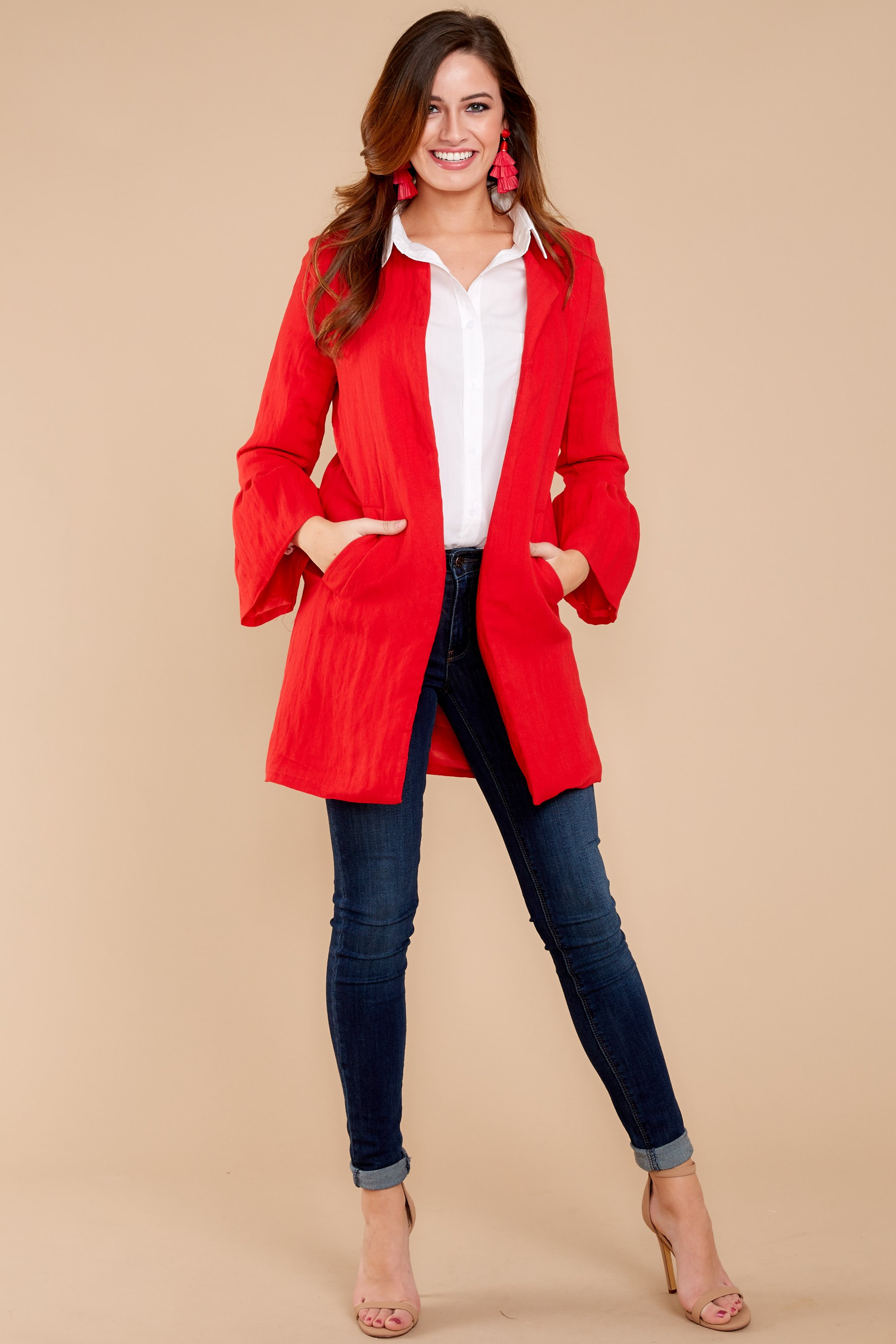 Get a perfect look with red coat at the Christmas festival